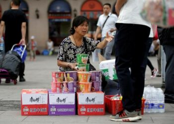 China's Private Services Sector Accelerates in July, But COVID-19 Threats Remain